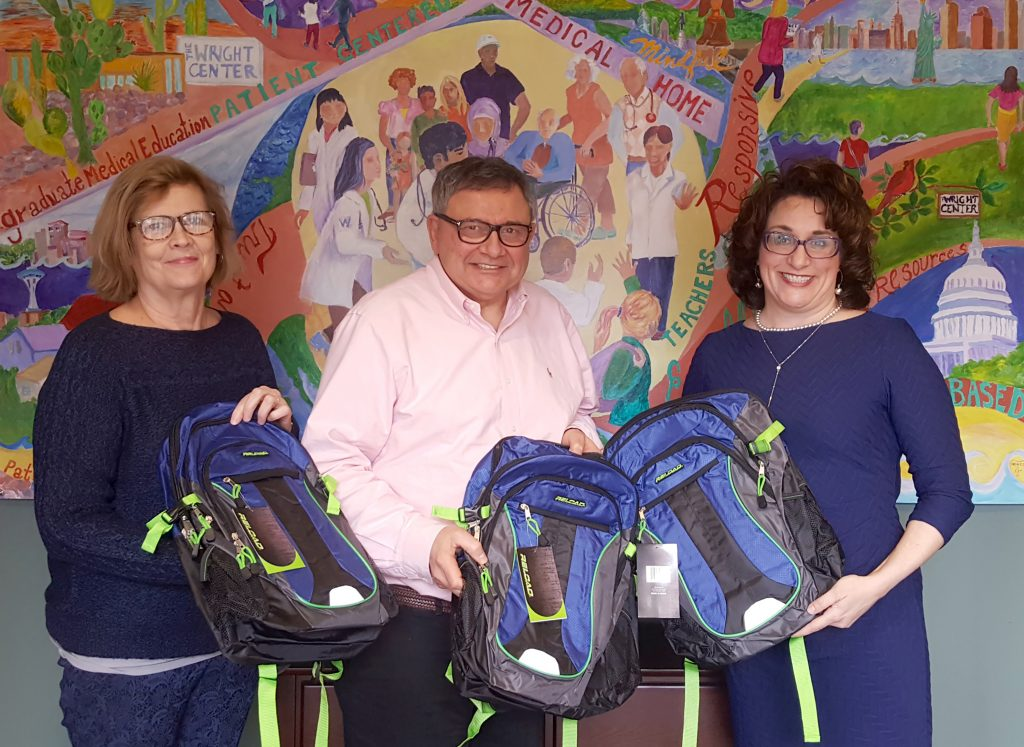 Wright-Center-Employees-Donate-Backpacks-to-Community-Intervention-Center-1024x747
